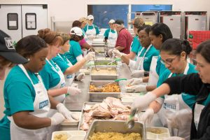 Image of Peoples Health staff preparing Thanksgiving meals.