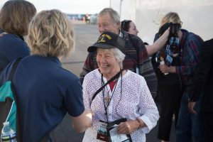 Peoples Health employee greeting attendee at the WWII veterans event at the Lakefront air show