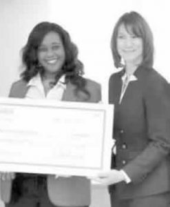 Leslie Keen of Peoples Health presenting check to Marcia Nelson of Paint Your Heart Out