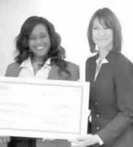 Leslie Keen of Peoples Health presenting check to Marcia Nelson of PYHO.