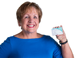 Senior female Peoples Health plan member holding a Peoples Health card and smiling