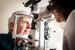 Senior man having an eye exam