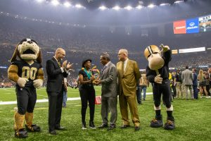 Dianna Beasley, Peoples Health Champion, being honored on the Saints field.