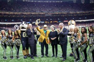 Peoples Health Champion Bob Stevens being honored on the Saints field.