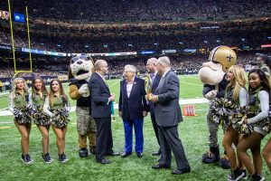Peoples Health Champion Paul Hilliard being honored on the Saints field.